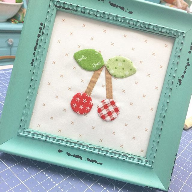 I love these little cherries from my Bee Happy Quilt so much that I had to put them in a frame!!!  #beeinmybonnet #beehappysewalong #sewsimpleshapes #beebasics #beebackgrounds #iloverileyblake #fabricismyfun