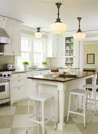 Great lighting in a lovely kitchen. Can't get enough of schoolhouse lights.