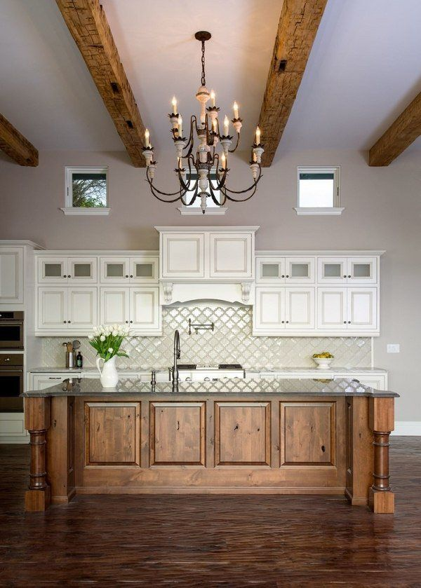 Mediterranean kitchen arabesque tile backsplash wooden kitchen island ceiling beams iron chandelier