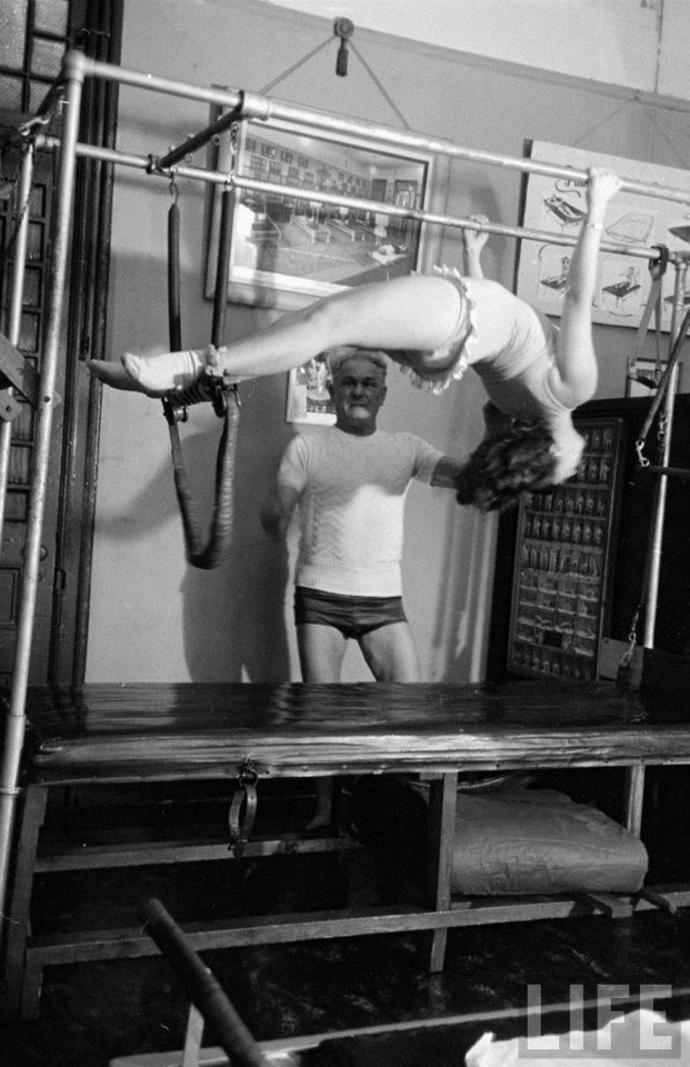 Opera singer Roberta Peters practicing with Joseph Pilates in his NY studio. Hanging Pull-Ups.  February 12, 1951. #pilates