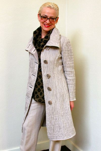 """<p>This flattering coat hugs you comfortably. Custom made fabric of uniquely scrunched and stitched linen with a touch of stretch. Linen lined, good fall and spring weight, yet breathable enough for cool summers.</p> <p>Available in <a href=""""http://faboofashion.com/products-page/jackets/greatest-fit-short-linen-jacket/"""">short version</a> too.</p> <p>NATURAL COLOR - ON SALE! Save!!</p> <p>Choose Natural from the drop down and see the lower price.</p>"""