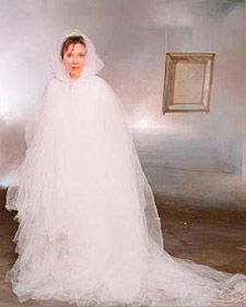 Seven layers of white nylon netting gathered at the neck with seam binding make an apparition as light as air.