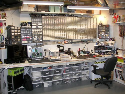 Serious workbench space. More parts drawers than our shop!