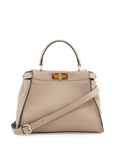 "Fendi Peekaboo satchel bag in silk calfskin. Golden hardware. Leather top handle with rings; 4"" drop. Hinged tortoise plexi frame-top. Button-tabs at sides. Front and back turn-lock compartments. Inte"