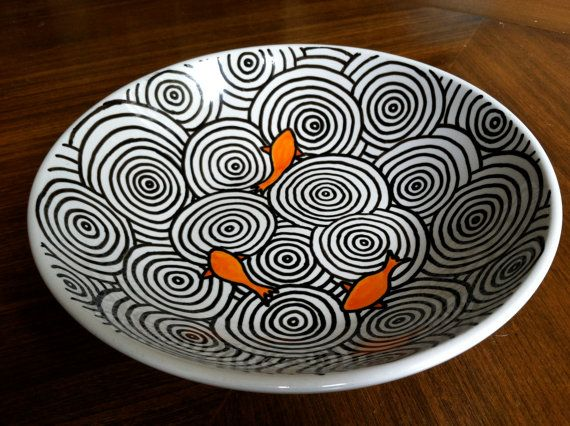 hand painted ceramic bowl with koi fish and zen-garden-like water ripples.    9 diameter bowl, 2.5 deep