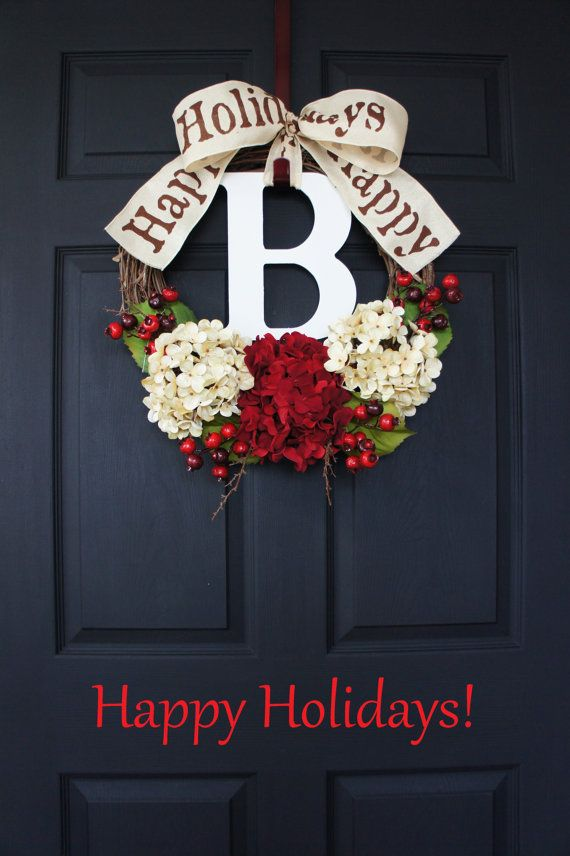 A gorgeous Hydrangea Happy Holiday Grapevine Wreath with lush Hydrangea blooms in red & antique white accented by a generous spread of light green