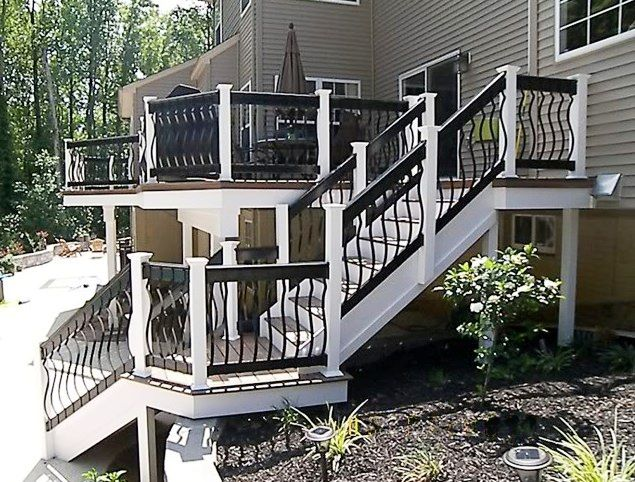 hnh deck and porch composite deck with fiberon ipe decking and deckorators black aluminum balusters railing available at yorkton building supplies - Porch Railing