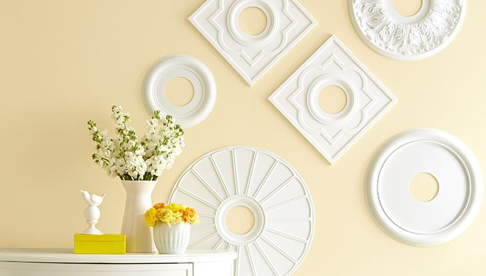 Hang a few ceiling medallions for bold wall art. -- Lowe's Creative Ideas