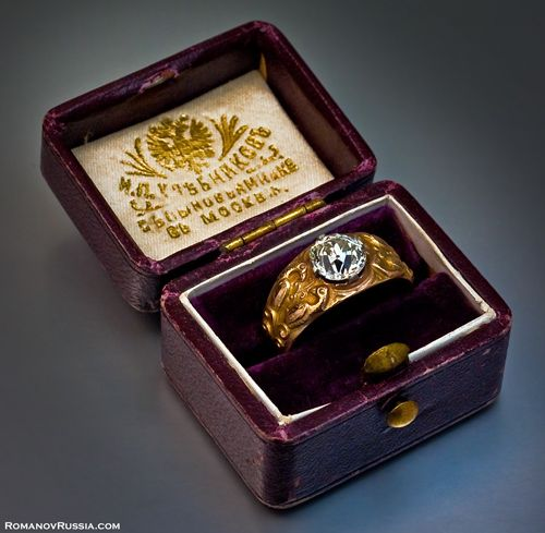 Romanov ring in the original burgundy leather case of the Khlebnikov jewelry firm, one of the biggest jewelers in the Russian Empire.  The case is stamped in gold with the Imperial Warrant - double headed eagle (Khlebnikov was a supplier of the Tsarist Court) and the following inscription:  I.P.Khlebnikov with Sons and Co. in Moscow