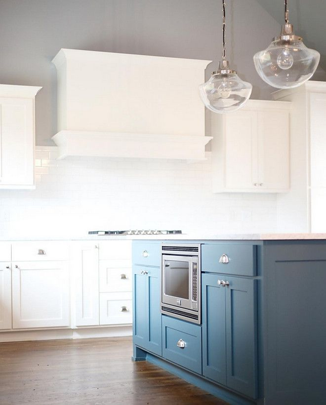"Kitchen Island Paint Color: ""Benjamin Moore Vanderberg Blue""; perimeter cabinets: Benjamin Moore White Dove; wall color: Benjamin Moore Coventry Gray. CBC Builds via Instagram. Photo by Sarah Baker."