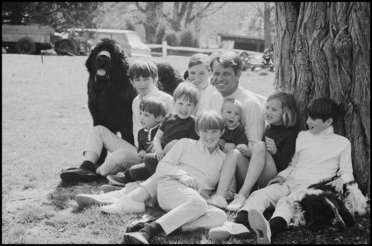 Burt Glinn, Robert Kennedy with nine of his children at their Hickory Hill home. It is the last weekend with his family before going on the campaign trail, McLean, Virginia, 1968