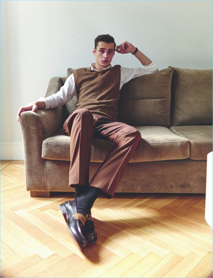 Relaxing, Adrien Sahores wears a sweater vest, trousers, and shoes by Ermenegildo Zegna. Adrien's look is complete with an Emidio Tucci shirt and Blancpain watch.