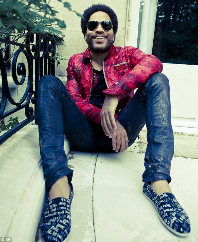 Designs on fashion: Lenny Kravitz wearing his 'Let Love Rule' shoes, part of a collection he has created with Toms founder Blake Mycoskie. For each pair sold, another pair will be given to a child in need