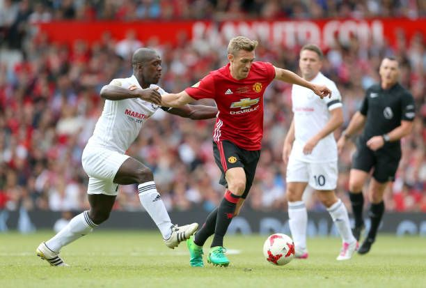 Carrick All Stars' Clarence Seedorf and Manchester United's Darren Fletcher battle for the ball during Michael Carrick's Testimonial match at Old...