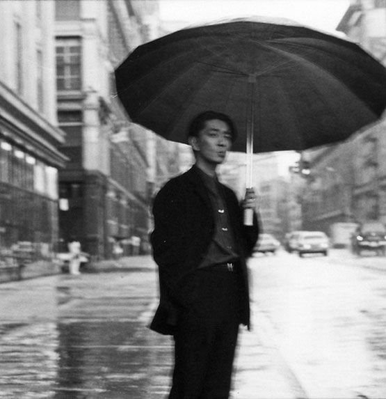 """By Jeannette Montgomery Barron: Ryuichi Sakamoto This was an assignment for a Japanese Magazine. The theme was """"A Day in New York with Sakamoto"""" or something to that effect. We rode around in a limo all day stopping to photograph Sakamoto at the gym, shopping at Barney's and at his favorite record store in the village, that kind of thing. At the end the day, I took this picture. The blurriness of the picture bothered me for years. Now I love it."""