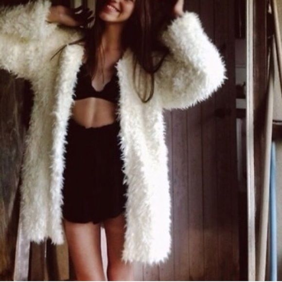 White fuzzy coat Warm creamy white fuzzy coat thing. Hook at breast area for closure. Super cute!!! I bought from another seller knowing it was too small for me but hoping I could make it work but never wore it so I'm selling it. (Previous owner said she only wore it once or twice) Forever 21 Jackets & Coats