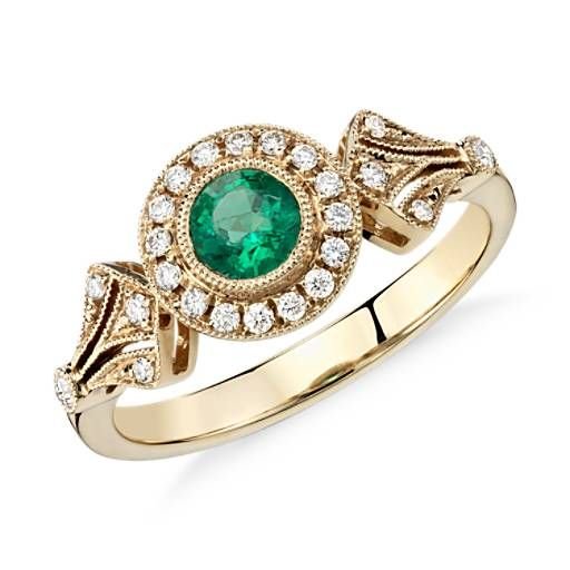 Inspired by vintage jewelry, this sophisticated 14k yellow gold ring features a milgrain halo with pavé-set diamonds that frame a beautiful emerald.