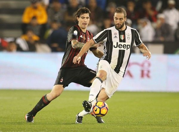 Gonzalo Gerardo Higuain of Juventus FC in action against Alessio Romagnoli of AC Milan during the Supercoppa TIM Doha 2016 match between Juventus FC and AC Milan at the Jassim Bin Hamad Stadium on December 23, 2016 in Doha, Qatar.