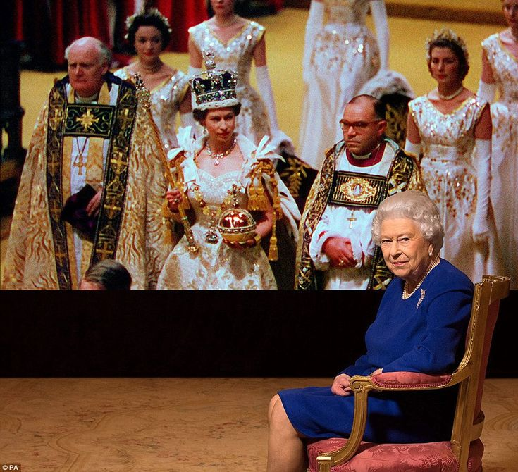 """dailymail: Queen Elizabeth is shown in front of footage of her coronation on June 2, 1953; the Queen gave a rare interview for the documentary """"The Coronation"""" to air in January 2018"""