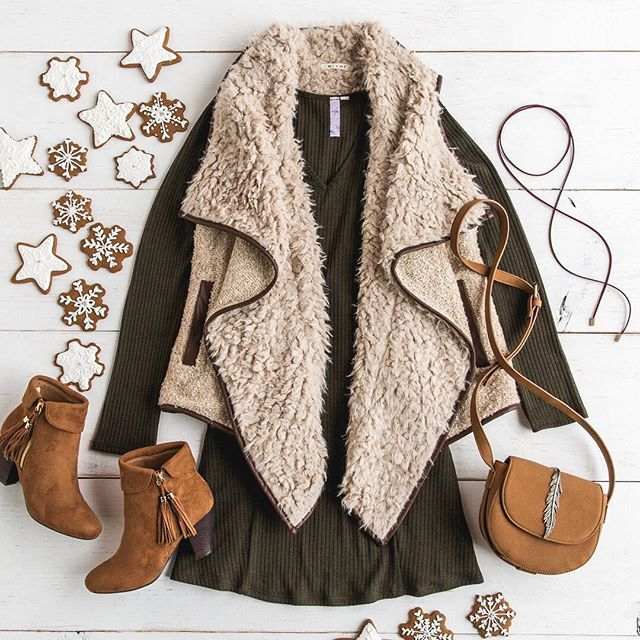Staying cozy & warm with our fave sherpa vests!