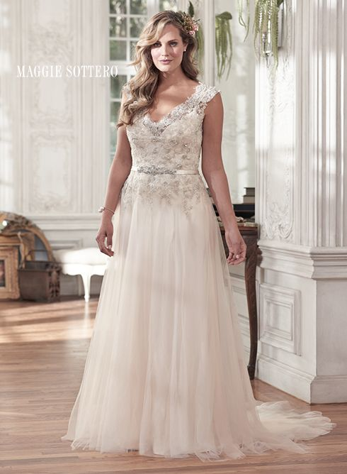Carmen plus size wedding dress by Maggie Sottero. Vintage Swarovski crystal embellished lace and tulle overlay this Valentina satin slip dress. Fabric covered buttons lead down to a satin waistband, adorned with Swarovski crystal applique.