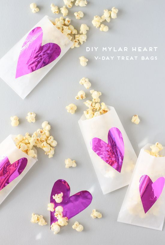 Make these super cute Mylar treat bags for Valentines Day treats! #diy #treatbags #valentines #valentinediy #favors