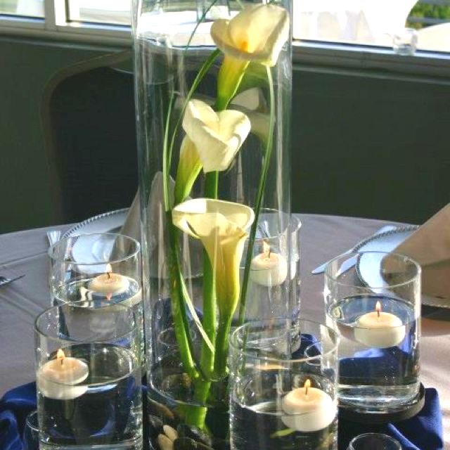 Tall calla lily centerpiece in glass vase with small