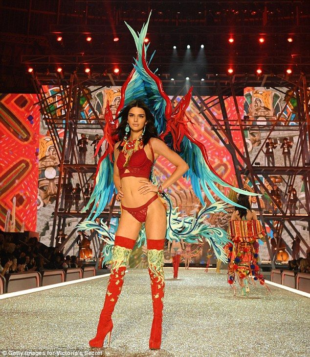 Lady in red: Kendall Jenner wowed as she graced the runway for the Victoria's Secret Fashi...