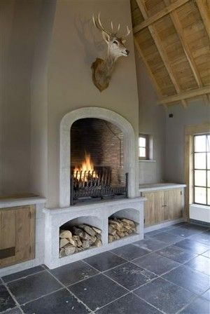 Rough concrete - deep fireplace - exposed wood = open statement