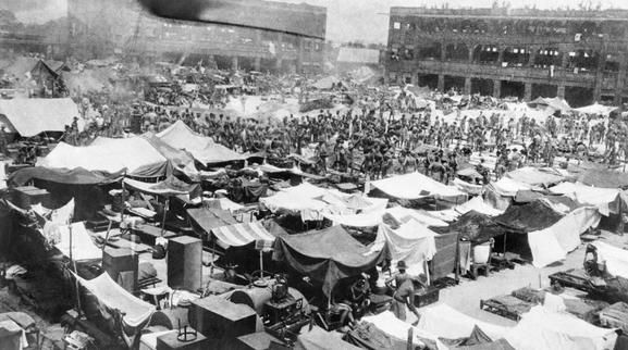 On 30 August 1942, the Japanese ordered the 20,100 prisoners of war in Changi Jail, Singapore, to sign an undertaking not to escape. The POWs refused and they were crowded into Selerang Barracks (which had accommodation for 120) until they signed under duress on 4 September. The photograph shows the crowded Barrack Square during what became known as the 'Selerang Incident'.