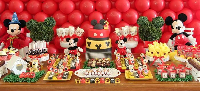 Mickey Mouse birthday party. Nice way to decorate the dessert table.
