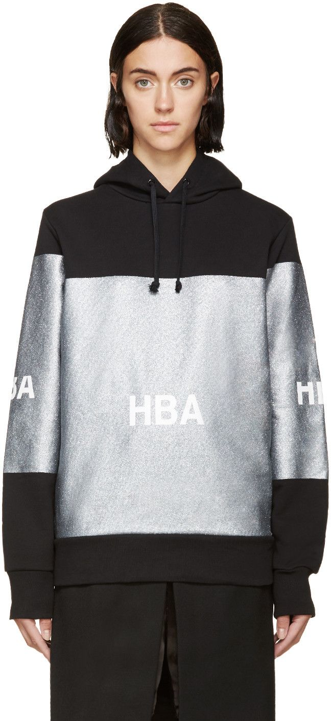 Long sleeve French terry hoodie in black. Silver-tone glitter panels printed throughout. Drawstring closure at hood. Logo printed in white at front and sleeves. Tonal stitching.