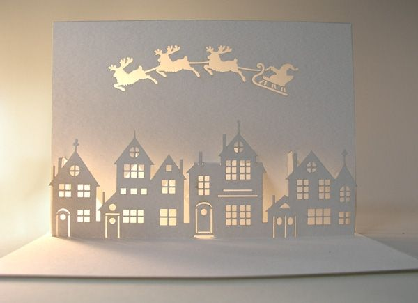Paper cut out card. Beautiful and calm with light behind it.