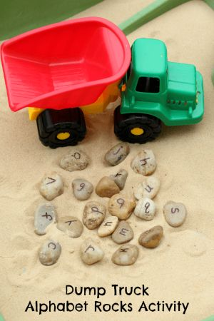 My son loves playing with dump trucks and rocks, so I came up with this dump truck alphabet stones activity. It was great way for him to move and learn!