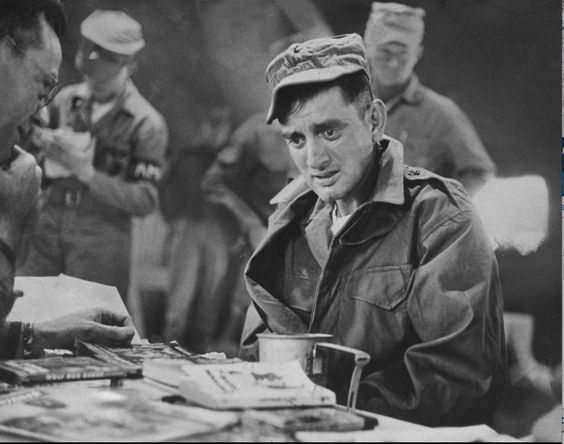 John Ploch, an imprisoned American who had not been reported as a POW by the North Koreans during the Korean War, sits in dazed disbelief as he is processed during a prisoner exchange, 1953.