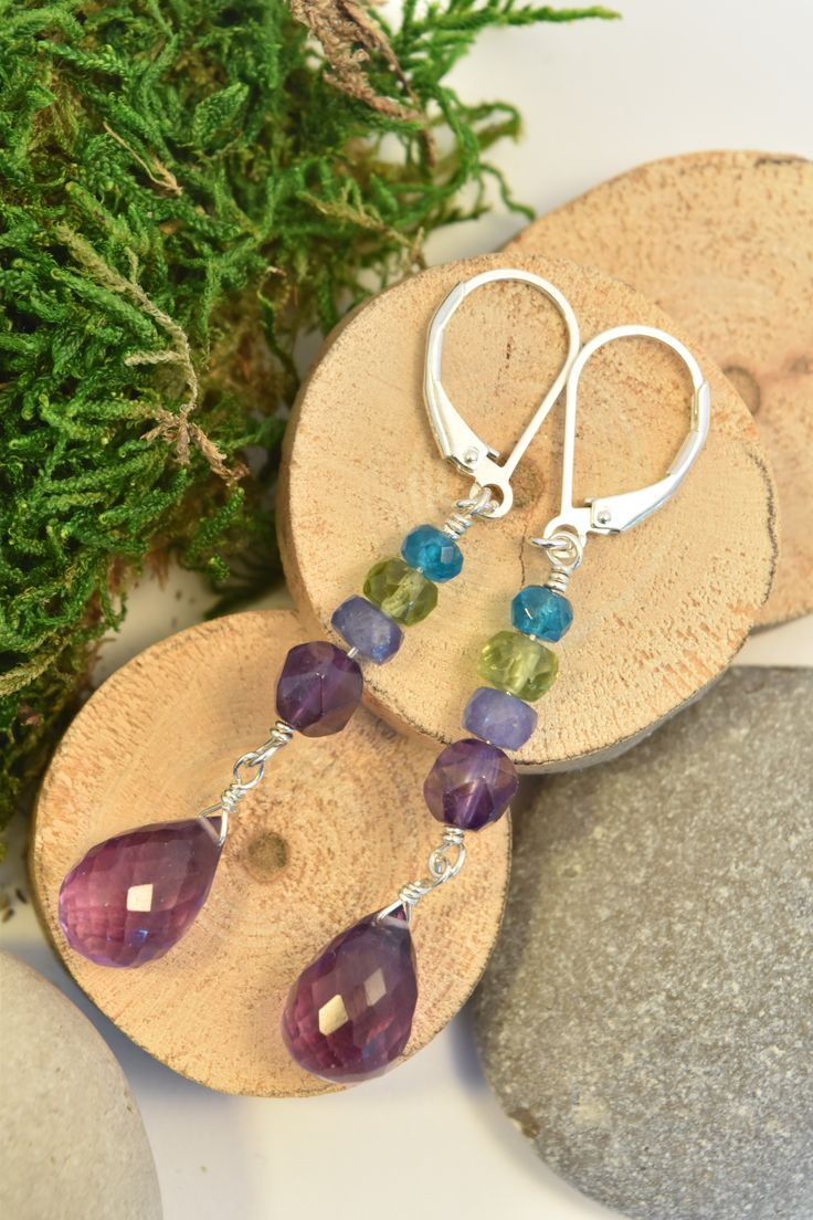 Amethyst, Peridot, Apatite & Tanzanite Dangle Earrings.  A stunning multi stone combination of natural gems in greens and purples. This unique jewelry was handmade and expertly finished in Sterling Silver by:  Love, Ludwiga - you can visit the shop: https://www.etsy.com/ca/shop/LoveLudwiga #loveludwiga