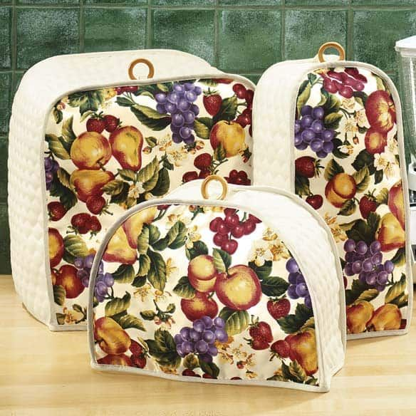 Kitchen appliance covers can easily be made to fit any of the small appliances that sit on your counter. These kitchen appliance covers can be crafted quickly in an afternoon.