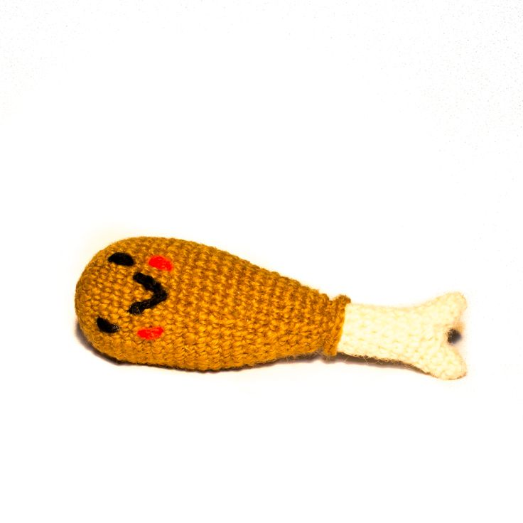 Brought to you from luxury boutique Ware of the Dog in New York City, this hand knitted chicken drumstick dog toy will make a fun and original addition to your dog's toy collection.   100% Lambswool, made with all natural dyes