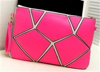 Modern cutout envelope clutch in pink from lovemisseve.com