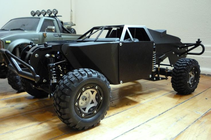 I want this Trophy Truck!!!  My favorite color, flat black!