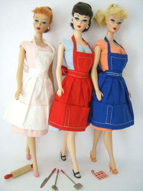 Three Vintage Pony Tail Swirl Barbie Dolls wearing aprons.  NO PATTERN  shouldn't be too hard to make without a pattern.