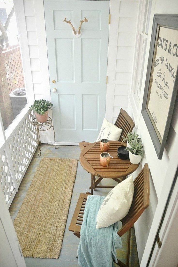 Ideas for storage door off balcony: hooks (hang dried flowers), pictures, wreath, mirror, etc