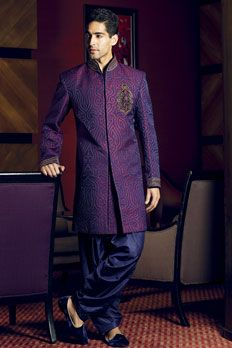 Pure silk indo-western sherwani with all over cutwork and small motif on chest highlighted with zardosi and velvet patch work.