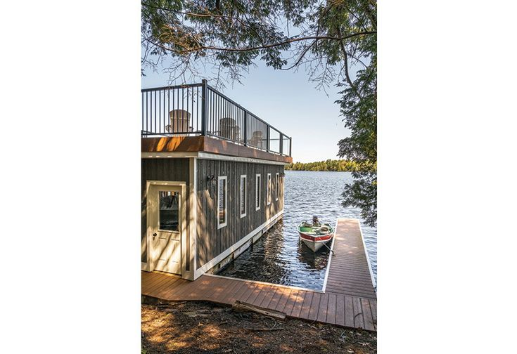"""Pre-engineered aluminum railings guard the sun deck perimeter as well as the sides of the ramp.    See more of this home in """"Wheelchair-Accessible Cottage for all Four Seasons"""" from OUR HOMES Muskoka Mid-Summer 2016  http://www.ourhomes.ca/articles/build/article/wheelchairaccessible-cottage-for-all-four-seasons"""