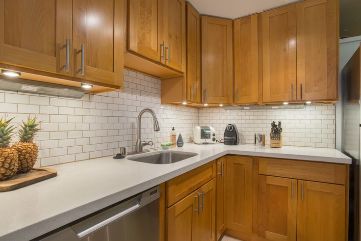 Beautifully renovated kitchen at our newest listing in Diamond Head! Stainless steel appliances, beautiful backsplash and counters. Have it all at 3055 Pualei Circle!