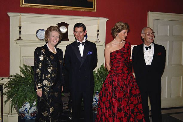 Prince Charles and Princess Diana attending a dinner at 10 Downing Street with Prime Minister Margaret Thatcher and her husband Denis, November 1989. Princess Diana is wearing a Catherine Walker evening gown.