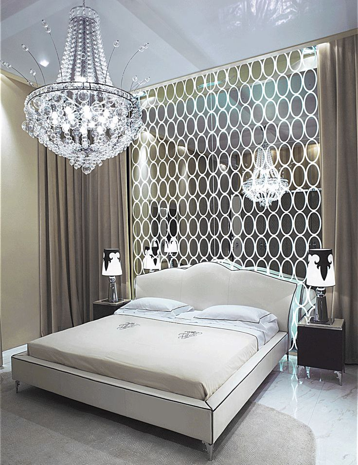 Glamorous Bedroom With Mirrored Wall And Ballroom Chandelier
