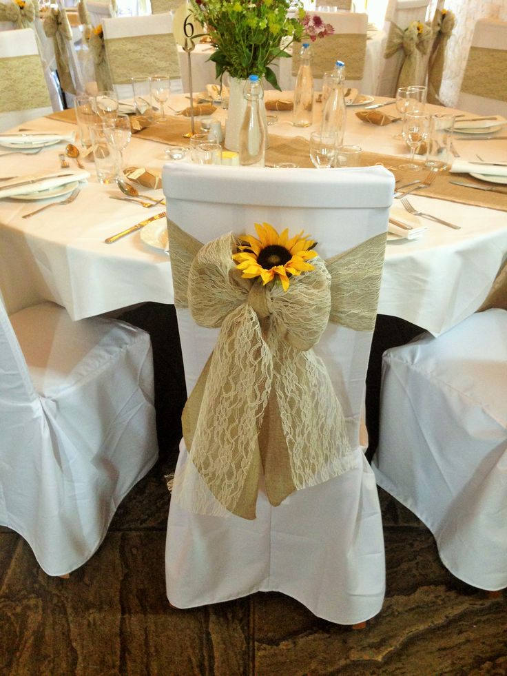 Hessian and lace sashes on white cotton chair covers at UftonCourt