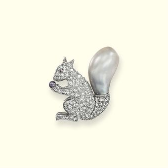 AN AMUSING NATURAL PEARL AND DIAMOND SQUIRREL BROOCH