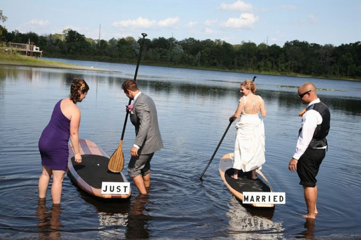 A Paddle Board Entrance And Departure For The Bride And Groom At The Secret  Garden.